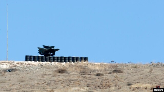 A rocket launcher is positioned at a military base on the Turkish-Syrian border town of Reyhanli, in Hatay province, southern Turkey, Sept. 5, 2013.
