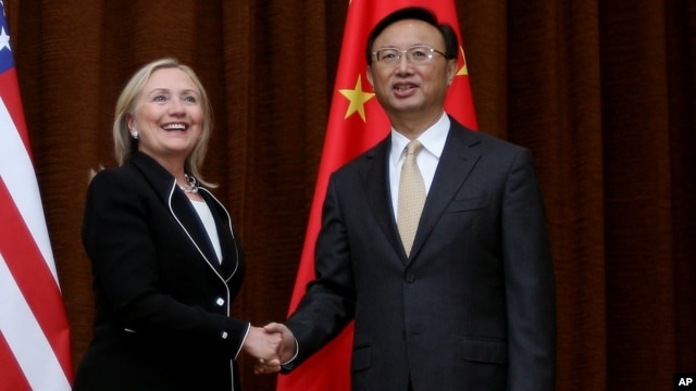 U.S. Secretary of State Hillary Rodham Clinton, left, and Chinese Foreign Minister Yang Jiechi, right, shake hands during her visit to Beijing, Sept. 4, 2012.
