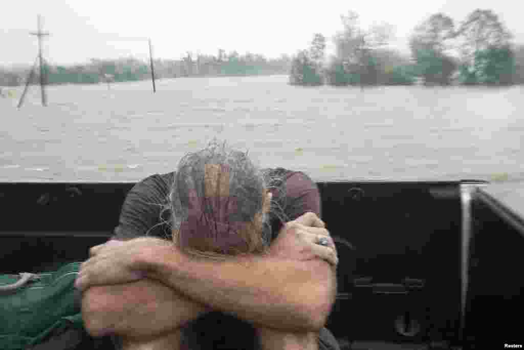 A resident of Plaquemines Parish who was rescued from his flooded home sits in the back of a pickup truck during Hurricane Isaac in Braithwaite, Louisiana August 29, 2012.