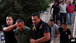 Members of Turkey armed forces are escorted by police for their suspected involvement in Friday's attempted coup, at the court house in Mugla, Turkey, July 17, 2016.