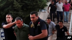 Members of Turkey armed forces are escorted by police for their suspected involvement in Friday's attempted coup at the court house in Mugla, Turkey, July 17, 2016.
