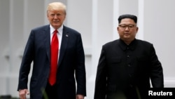 特朗普总统和金正恩主席在新加坡会谈(2018年6月12日路透社)