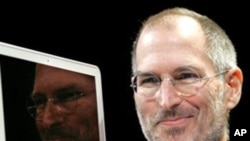 FILE - In this Jan. 15, 2008, file photo, Apple CEO Steve Jobs holds up the new MacBook Air after giving the keynote address at the Apple MacWorld Conference in San Francisco. Apple on Wednesday, Oct. 5, 2011 said Jobs has died. He was 56. (AP Photo/Jeff