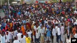 Protesters march near the scene of Saturday's massive truck bomb attack in Mogadishu, Somalia, Oct. 18, 2017.