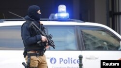FILE - A Belgian special forces police officer stands guard outside a courthouse, Brussels, Belgium, April 7, 2016.