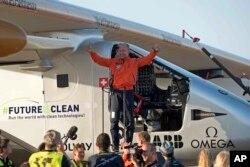 Pilot Bertrand Piccard, celebrates after landing the solar-powered plane at San Pablo airport in Seville, Spain Thursday, June 23, 2016.