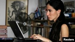 Yoani Sanchez works on her laptop at her home in Havana, February 9, 2011.