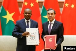 China's Foreign Minister Wang Yi and Burkina Faso Foreign Minister Alpha Barry attend a signing ceremony establishing diplomatic relations between the two countries in Beijing, China, May 26, 2018.