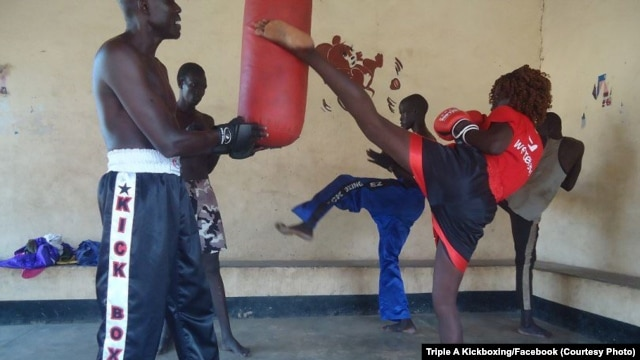 Winnie Natasha (R) delivers a targeted kick during training with the Triple A Kickboxing team in Juba.