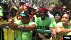 Zanu-PF supporters outside parliament during the official opening ceremony Tuesday