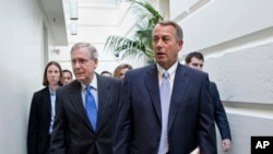 FILE - House Speaker John Boehner (r) walks with Senate Minority Leader Mitch McConnell.
