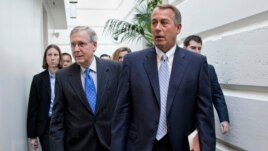 House Speaker John Boehner of Ohio, right, walks with Senate Minority Leader Mitch McConnell of Ky., left, as they make their way to a GOP strategy session on Capitol Hill in Washington, Nov. 19, 2013.