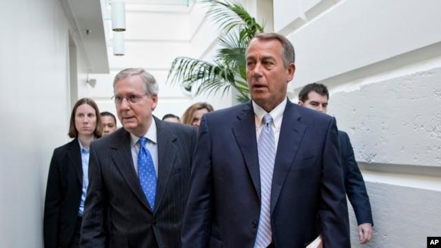 FILE - House Speaker John Boehner (r) walks with Senate Minority Leader Mitch McConnell.