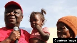 Morgan Tsvangirai captured at a village in Zimbabwe visiting some citizens.