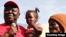 Morgan Tsvangirai captured at a village in Zimbabwe visiting some citizens.
