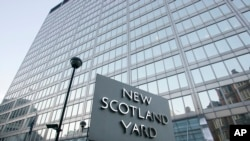 FILE - The Scotland Yard headquarters building is seen in London, Dec. 20, 2010. British police on Tuesday arrested four soldiers on suspicion of being members of an outlawed neo-Nazi group and planning terrorist acts.