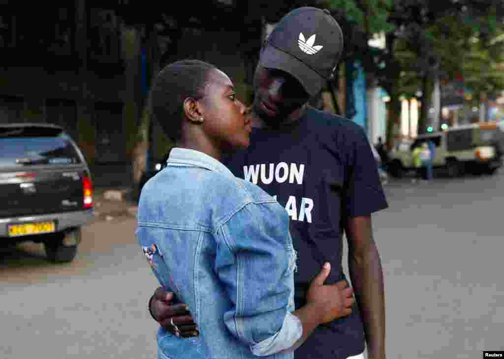 """Tony Wakaiga, 18, an art and design student and Suzzy Konje, 18, a hospitality management student, pose for a photograph after their date as they walk along Banda Street in Nairobi, Kenya, Feb. 11, 2018. Tony met Suzzy at a modeling photo session on Banda Street and they soon started dating. """"We have been very good friends for a long time and our passion for each other has matured like wine. This Valentine's Day, I have a special surprise for Suzzy that will knock her heart out,"""" Tony said."""
