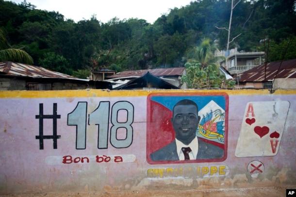 FILE - A mural feature senatorial candidate Guy Philippe in Pestel, Haiti, Aug. 25, 2016.