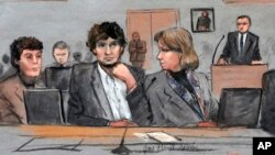 FILE - In this courtroom sketch, Dzhokhar Tsarnaev, center, is depicted between defense attorneys Miriam Conrad, left, and Judy Clarke, right, during his federal death penalty trial.