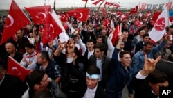 Supporters of Devlet Bahceli, the leader of the Nationalist Movement Party (MHP), chant slogans as he addresses a rally ahead of the Nov. 1 general elections, in Istanbul, Oct. 18, 2015.