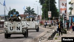 Peacekeepers serving in the United Nations Organization Stabilization Mission in the Democratic Republic of the Congo (MONUSCO) patrol in their armored personnel carrier during demonstrations against Congolese President Joseph Kabila in the streets of the