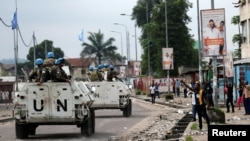 FILE - Peacekeepers serving in the United Nations Organization Stabilization Mission in the Democratic Republic of the Congo (MONUSCO) patrol in their armored personnel carrier during demonstrations against Congolese President Joseph Kabila, Dec. 20, 2016.