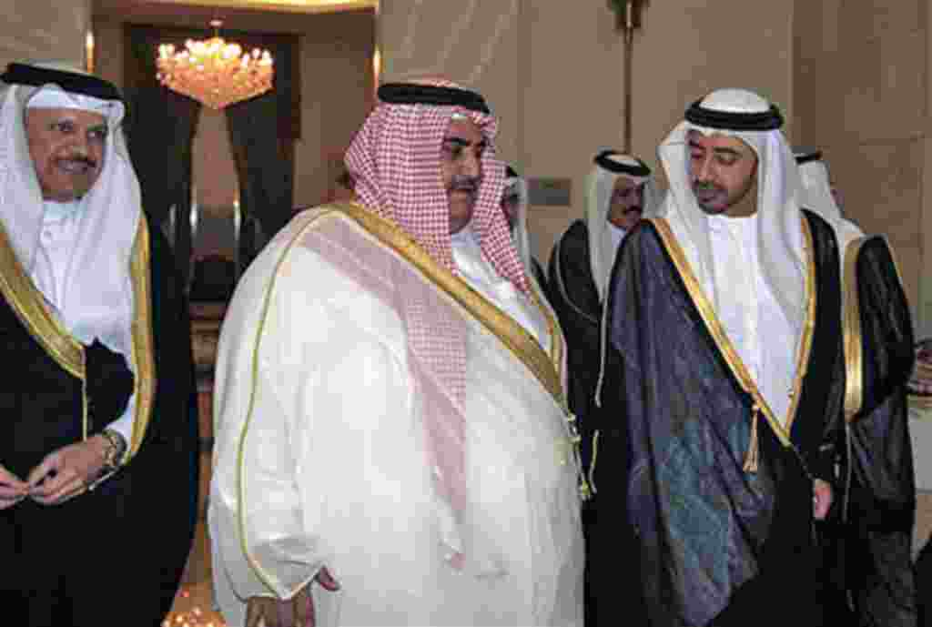 Bahrain's Foreign Minister Sheikh Khaled bin Ahmad al-Khalifa, center, welcomes United Arab Emirates Foreign Minister, Sheik Abdullah bin Zayed Al Nahyan, right, as the New Secretary General of the GCC, Dr. Abdullatif bin Rashid Al-Zayani, smiles at the G