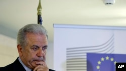 FILE - EU Migration Commissioner Dimitris Avramopoulos, shown at a news conference after a meeting with local officials in Athens on June 12, 2015.