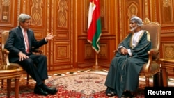 U.S. Secretary of State John Kerry (L) meets with Oman's Sultan Qaboos bin Said at Bait Al Baraka in Muscat, Oman, May 21, 2013.
