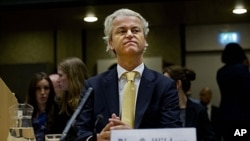受到控告的吉尔特.怀尔德6月23日在阿姆斯特丹的法庭上