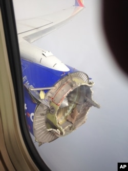FILE - This Saturday, Aug. 27, 2016 photo shows an engine through a window of a Southwest Airlines flight. The flight from New Orleans bound for Orlando, Fla., diverted to Pensacola, Fla., after the pilot detected something had gone wrong with an engine