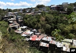 FILE - This March 29, 2019, photo shows a bird's eye view of La Carpio, a shantytown on the outskirts of San Jose, Costa Rica. The number of Nicaraguan exiles living in La Carpio has swelled since the Nicaraguan protests that began last April.