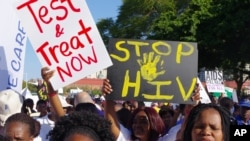 Manifestations à l'ouverture de la 21e Conférence internationale sur le sida, Durban, Afrique du Sud, 18 juillet, 2016. (AP Photo)