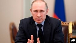 Russian President Vladimir Putin speaks at a Security Council meeting at the Kremlin in Moscow, Russia, March 28, 2014.