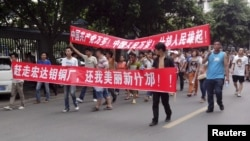 Local residents march during a protest along a street in Shifang, Sichuan province July 3, 2012.