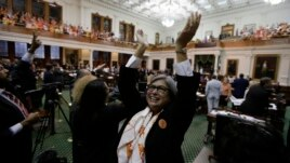 Democratic members cheer as the Texas Senate tries to bring an abortion bill to a vote as time expires, in Austin, Texas, June 26, 2013.