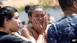 A student cries outside the Raul Brasil State School in Suzano, the greater Sao Paulo area, Brazil, Wednesday, March 13, 2019. The state government of Sao Paulo said two teenagers, entered the school and began shooting at students. (AP Photo/Andre Penner)