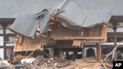 The Tozen-ji shrine building is one of the few in town still standing, Natori, Japan, March 21, 2011