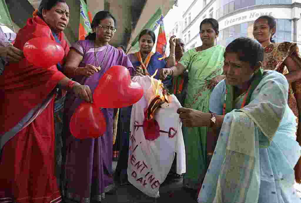 Activists from the Bharatiya Janata Party burn an effigy representing Valentine's Day during an anti-Valentine's Day protest in the southern Indian city of Hyderabad February 14, 2012. (REUTERS)