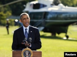 FILE - President Barack Obama delivers a statement at the White House in Washington on airstrikes in Syria, prior to departing for the United Nations in New York, Sept. 23, 2014.