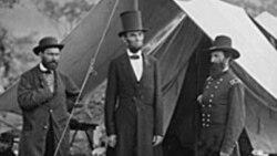 President Abraham Lincoln, center, is seen in Maryland in 1862. The Abraham Lincoln Presidential Library and Museum in Illinois is questioning whether a stovepipe hat at the museum once belonged to the former president.
