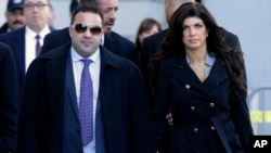 "FILE - Giuseppe ""Joe"" Giudice, left, and his wife, Teresa Giudice, of Montville Township, N.J., walk out of Martin Luther King Jr. Courthouse after a court appearance, in Newark, N.J., Nov. 20, 2013."