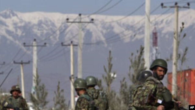 An Afghan National Army soldiers keeps watch after an attack at Camp Phoenix in Kabul April 2, 2011