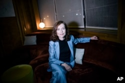 French actress Isabelle Huppert poses for photographer after an interview with the Associated Press in Paris, France, Jan. 24, 2017.