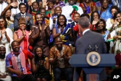 "FILE - President Barack Obama is welcomed by Young African Leaders Initiative participants as they shout, ""Happy birthday,"" in Washington, Aug. 3, 2016."