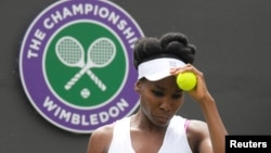 Venus Williams of the United States prepares to serve during her match against Belgium's Elise Mertens on the opening day at the Wimbledon Tennis Championships in London, July 3, 2017.