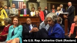 """A photo shot and tweeted from the floor of the U.S. House of Representatives shows Democratic members of the House staging a sit-in on the House floor """"to demand action on common sense gun legislation"""" on Capitol Hill, in Washington, June 22, 2016."""