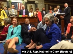 "FILE - A photo shot and tweeted from the floor of the U.S. House of Representatives shows Democratic members of the House staging a sit-in on the House floor ""to demand action on common sense gun legislation"" on Capitol Hill, in Washington, June 22, 2016."