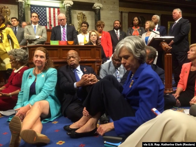 """FILE - A photo shot and tweeted from the floor of the U.S. House of Representatives shows Democratic members of the House staging a sit-in on the House floor """"to demand action on common sense gun legislation"""" on Capitol Hill, in Washington, June 22, 2016."""