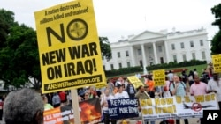 Demonstrators protest outside of the White House in Washington against renewed U.S. involvement in Iraq in Washington, D.C., June 21, 2014.